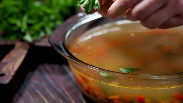 light vegetable soup with fish stock - parsley stock videos and b-roll footage