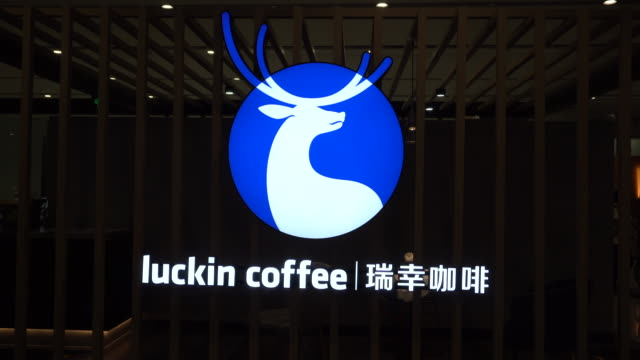lightbox of a luckin coffee store in beijing daxing international airport. on the evening of may 17, lucking coffee officially listed on nasdaq,... - chain store stock videos & royalty-free footage