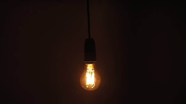 lightbulb swinging backwards and forwards. - pendant light stock videos & royalty-free footage
