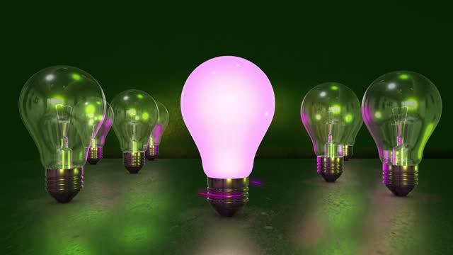 vidéos et rushes de ampoules 3d 4k sur fond sombre. concept d'idée. animation 3d - fond multicolore