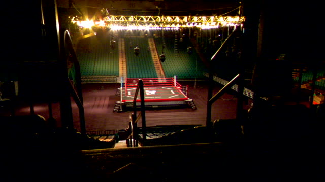 ls lighted arena amp boxing ring from top of stairs dolly forward xws arena - boxing ring stock videos & royalty-free footage