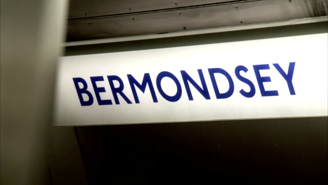 stockvideo's en b-roll-footage met a lighted bermondsey sign hangs in a london tube train. available in hd. - bermondsey