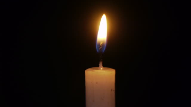 lighted candles in the night - candle stock videos and b-roll footage
