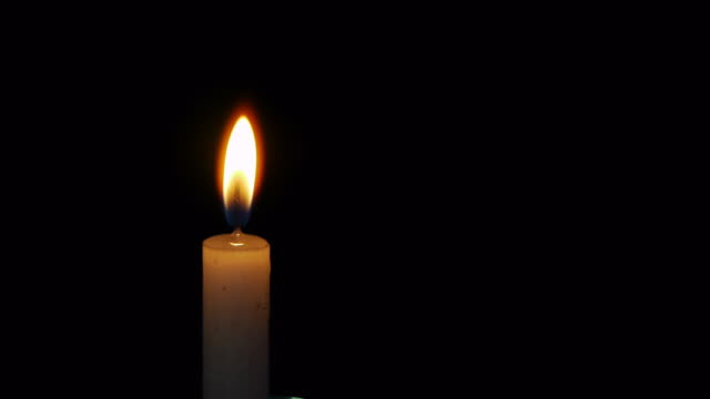 lighted candles in the night - candlelight stock videos and b-roll footage