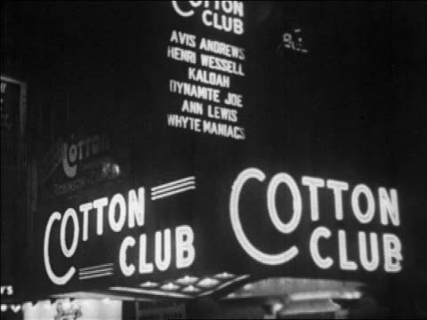 b/w 1928 lighted marquee of cotton club at night / nyc / newsreel - 1920 stock videos & royalty-free footage