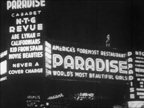 vídeos y material grabado en eventos de stock de b/w 1928 lighted marquee of paradise club at night / nyc / newsreel - 1928
