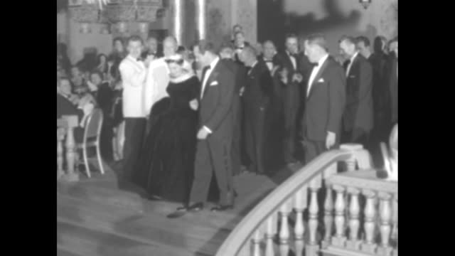 Ambassador Cocoanut Grove Salute to A Star is Born Judy Garland / actress and star of A Star is Born Judy Garland walks down steps with her husband...