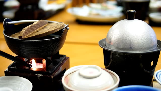 Lighter with fire to the clay pot