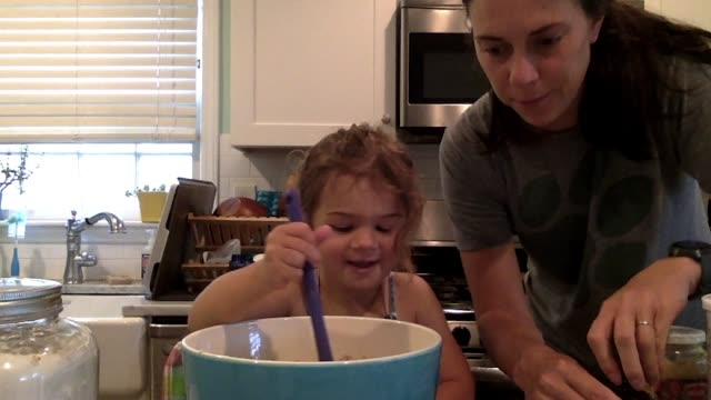 lighthearted mother and daughter add cinnamon to their bowl and mix ingredients together (audio) - messy stock videos & royalty-free footage