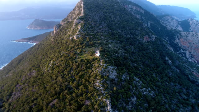 lighthouse and headland at sunset - drone shots of gelidonya lighthouse / andrasan / antalya - cape stock videos & royalty-free footage
