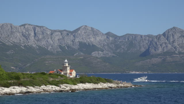 POV / Lighthouse and motorboat on Hvar island
