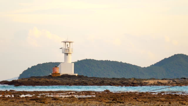 4k lighthouse and rocky coastline at dusk ,phuket - finisterra bretagna video stock e b–roll