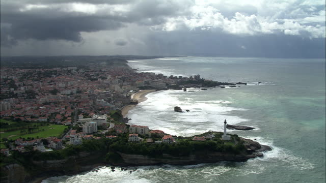 aerial, lighthouse at biarritz, aquitaine, france - aquitaine stock-videos und b-roll-filmmaterial