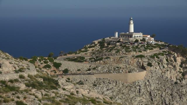 lighthouse at cap formentor, majorca, balearic islands, spain, mediterranean, europe - ローカルな名所点の映像素材/bロール