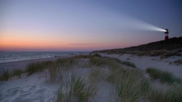lighthouse at dawn - sanddüne stock-videos und b-roll-filmmaterial