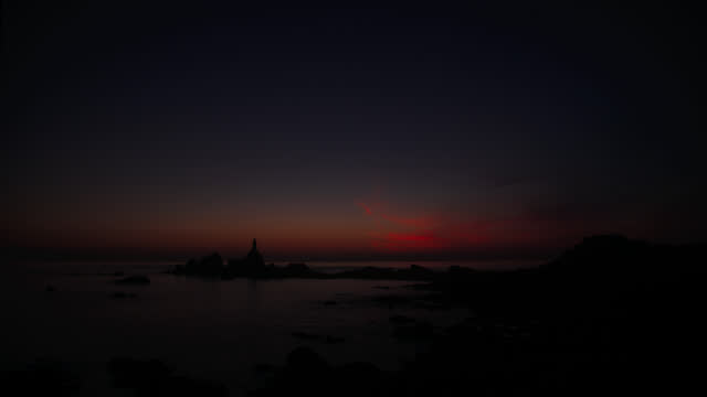 lighthouse at dusk - channel islands england stock videos & royalty-free footage