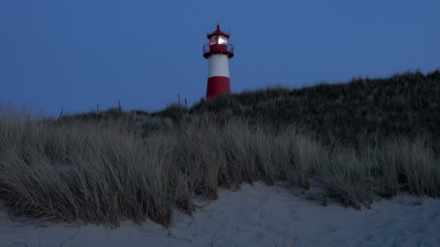 lighthouse at dusk - north frisian islands stock videos & royalty-free footage