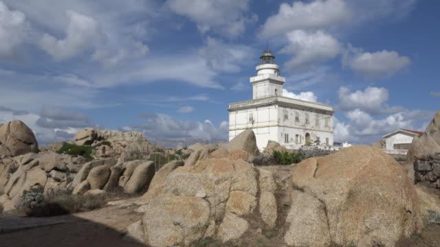 lighthouse at granite rocks on capo testa - sassari stock videos & royalty-free footage