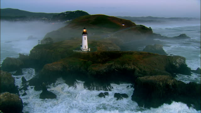 AERIAL Lighthouse at Pacific coast at sunset, Oregon, USA