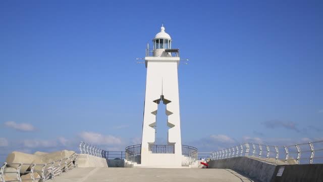 lighthouse at songdaemal headland, gampo beach, gyeongju, south korea - 韓国点の映像素材/bロール