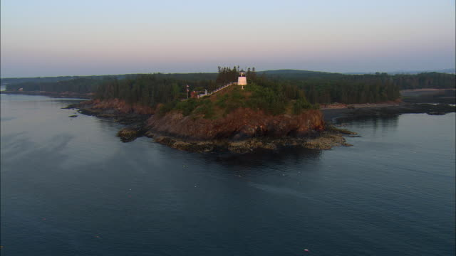 vidéos et rushes de low aerial, lighthouse at sunrise, owls head, maine, usa - maine