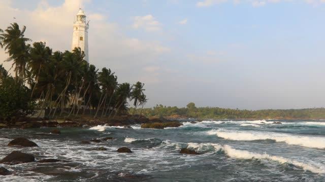 lighthouse dondra head at sunset, sri lanka - sri lanka stock videos & royalty-free footage