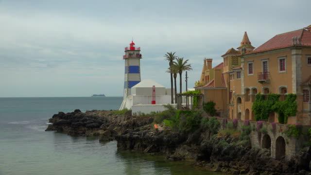 lighthouse farol de santa marta, cascais, coast of lisbon. portugal - cascais stock videos and b-roll footage
