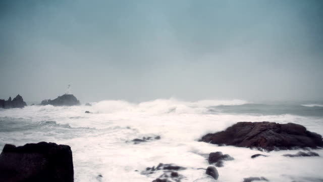 lighthouse in a storm - coastal feature stock videos & royalty-free footage