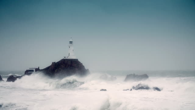 lighthouse in a storm - lighthouse stock videos & royalty-free footage