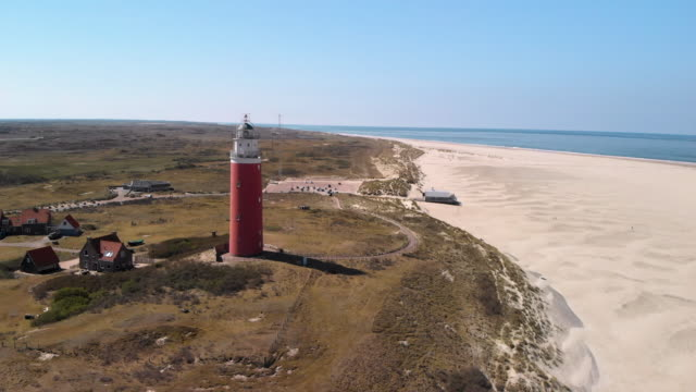 lighthouse in texel island netherlands - dutch culture stock videos & royalty-free footage