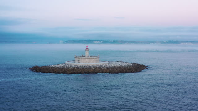lighthouse in the middle of the ocean, foggy environment - protection stock videos & royalty-free footage