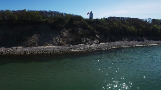lighthouse leading the way to denmark - danish flag stock videos and b-roll footage
