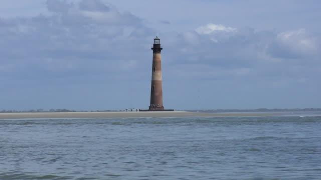 lighthouse - morris island, south carolina - charleston south carolina stock videos & royalty-free footage