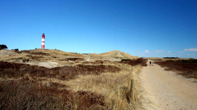 lighthouse of amrum with foodpath - north frisian islands stock videos & royalty-free footage
