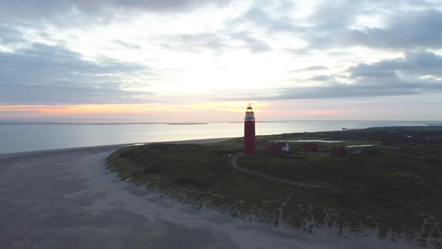 stockvideo's en b-roll-footage met lighthouse of texel during sunset - vuurtoren