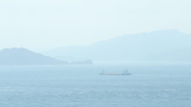 vídeos de stock, filmes e b-roll de lighthouse on cape sada and the hoyo strait - estreito mar