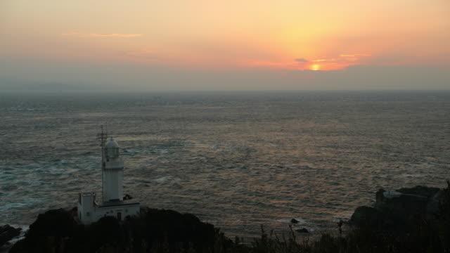 lighthouse on cape sada and the hoyo strait - stretto video stock e b–roll