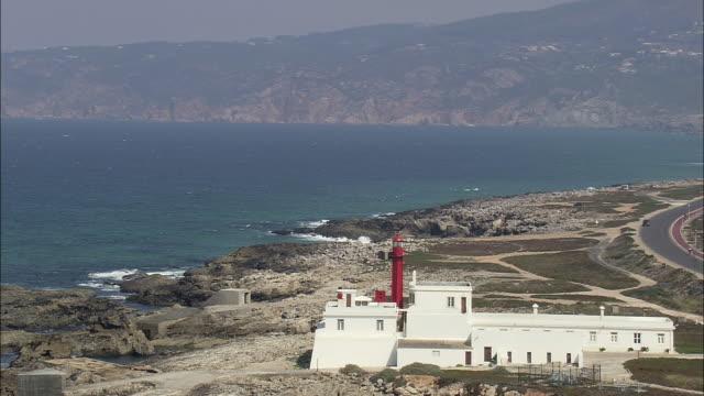 aerial ws lighthouse on far western edge of parque natural de sintra-cascais / cascais, lisbon, portugal - cascais stock videos and b-roll footage