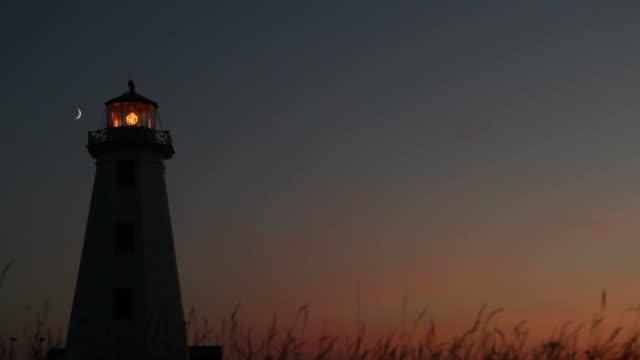 lighthouse on prince edward island under breathtaking sunset - lighthouse stock videos & royalty-free footage