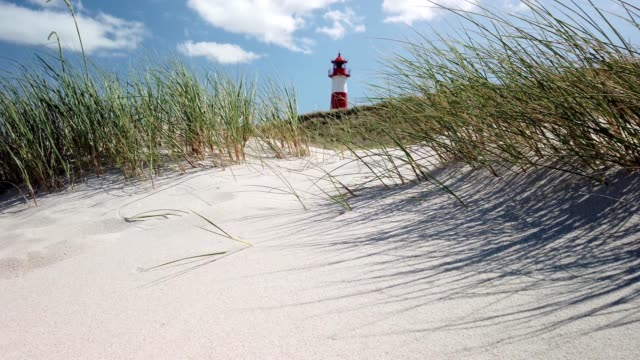 stockvideo's en b-roll-footage met lighthouse on the beach of sylt - leuchtturm am ellenbogen auf sylt - tina terras michael walter
