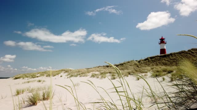 "stockvideo's en b-roll-footage met lighthouse on the beach of sylt. leuchtturm auf sylt - ellenbogen"" - tina terras michael walter"
