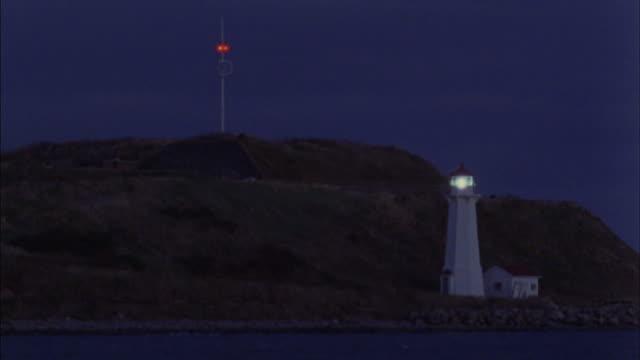 A lighthouse overlooks the harbor.