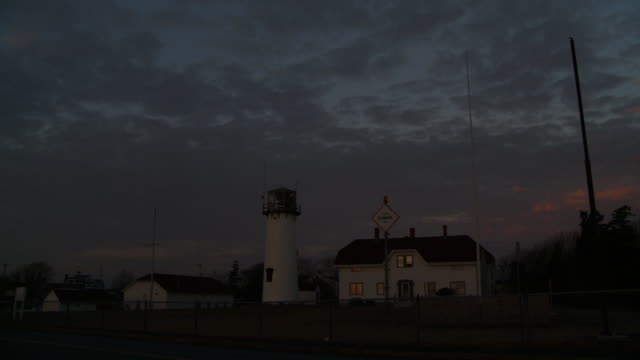 a lighthouse rotates at night in cape cod. - lighthouse stock videos & royalty-free footage