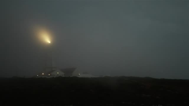 lighthouse sending light signals in the fog - lighthouse stock videos & royalty-free footage