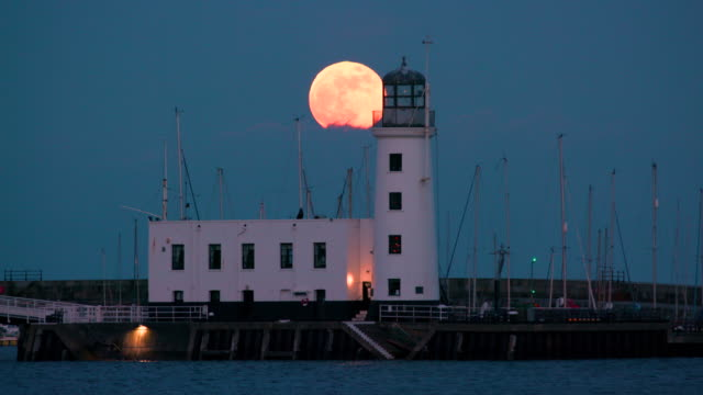 Lighthouse & Supermoon Rise, Scarborough, North Yorkshire, England