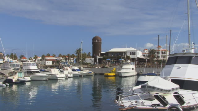 ws, zi, lighthouse with marina in foreground / caleta de fuste, fuerteventura, canary islands, spain - unknown gender stock videos & royalty-free footage
