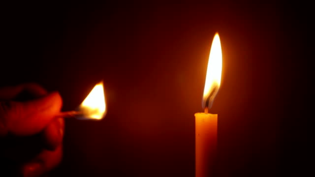 lighting a candle with match - candlelight stock videos and b-roll footage