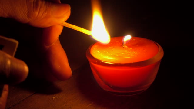 lighting aromatherapy candle with match - religion stock videos & royalty-free footage