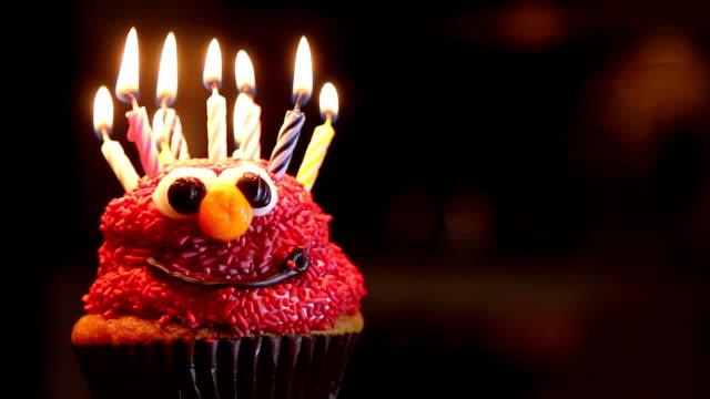 lighting birthday candles on cupcake - cupcake stock videos & royalty-free footage