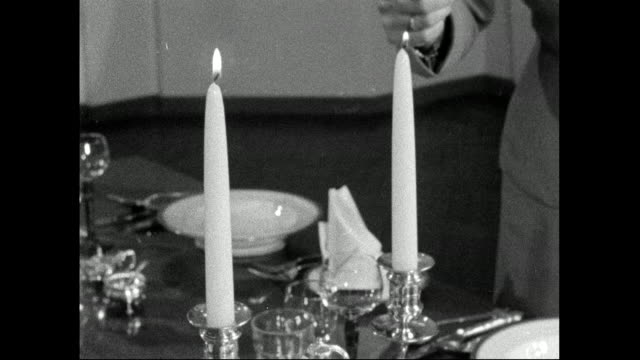 lighting candles at dinner table; 1958 - candlelight stock videos & royalty-free footage